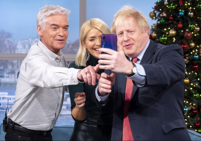 Editorial use only Mandatory Credit: Photo by Ken McKay/ITV/REX/Shutterstock (10492311w) Phillip Schofield and Holly Willoughby with Boris Johnson 'This Morning' TV show, London, UK - 05 Dec 2019 DAYTIME EXCLUSIVE: PRIME MINISTER BORIS JOHNSON In just seven days, the nation will go to the polls in what many have labelled the most vital general election of our generation. But who will hold the keys to Number 10 by the end of next week? Well one man who?s hoping to stay put this Christmas, is Prime Minister Boris Johnson. In a Daytime exclusive, the Prime Minister joins us on the sofa today. We?ll be asking if he is planning to sell our NHS to Donald Trump, whether he really believes Brexit will be done by the end of January, and if he thinks he?ll still have a job in a week?s time.