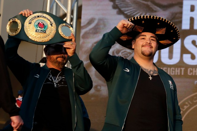 Heavyweight boxer Andy Ruiz Jr gestures to the crowd as he makes his entrance for the weigh-ins