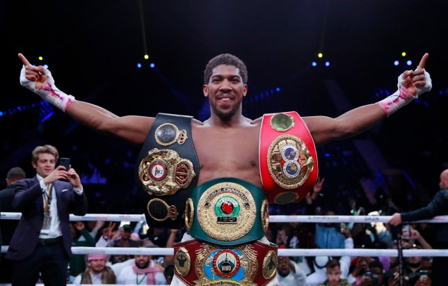 Anthony Joshua poses with IBF, WBO and WBA (Super) belts after beating Andy Ruiz