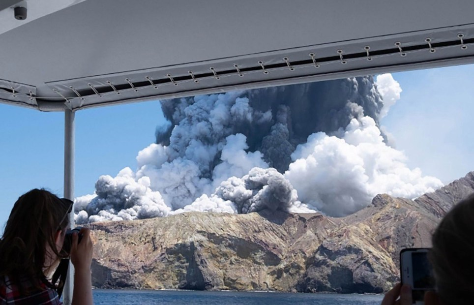 "This handout photograph courtesy of Michael Schade shows the volcano on New Zealand's White Island spewing steam and ash moments after it erupted on December 9, 2019. - New Zealand police said at least one person was killed and more fatalities were likely, after an island volcano popular with tourists erupted on December 9 leaving dozens stranded. (Photo by Handout / Michael Schade / AFP) / RESTRICTED TO EDITORIAL USE - MANDATORY CREDIT ""AFP PHOTO / MICHAEL SCHADE"" - NO MARKETING NO ADVERTISING CAMPAIGNS - DISTRIBUTED AS A SERVICE TO CLIENTS == NO ARCHIVE (Photo by HANDOUT/Michael Schade/AFP via Getty Images)"