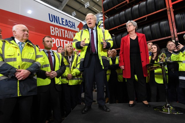 Former Labour MP, Gisela Stuart (right) listens as Prime Minister Boris Johnson speaks during a visit to Fergusons Transport in Washington, Tyne & Wear, while on the General Election campaign trail. PA Photo. Picture date: Monday December 9, 2019. See PA story POLITICS Election. Photo credit should read: Stefan Rousseau/PA Wire