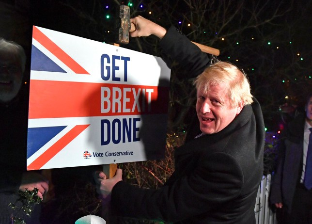 Britain's Prime Minister and Conservative party leader Boris Johnson with a Get Brexit Done sign