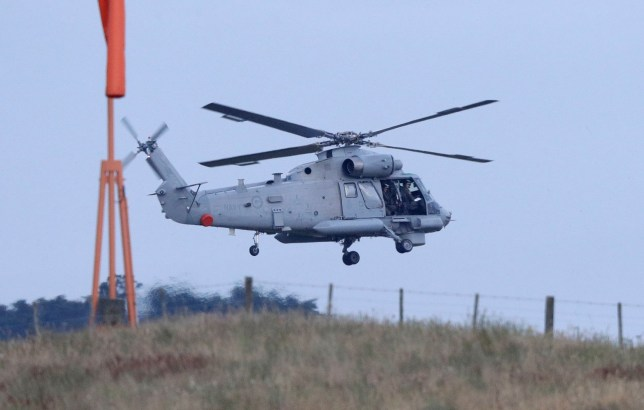 A New Zealand Navy helicopter takes off from Whakatane Airport as the mission to return victims of the White Island eruption begins in Whakatane, New Zealand, Friday, Dec. 13, 2019. A team of eight New Zealand military specialists landed on White Island early Friday to retrieve the bodies of victims after the Dec. 9 eruption. (AP Photo/Mark Baker)