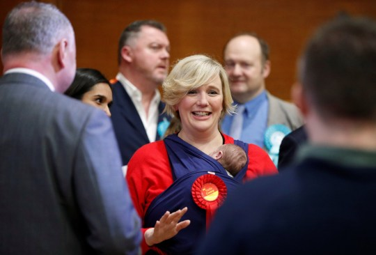 Labour candidate for Walthamstow Stella Creasy carries her baby daughter as she speaks after winning in Britain's general election in Waltham Forest Town Hall, Walthamstow, Britain, December 12, 2019. REUTERS/John Sibley