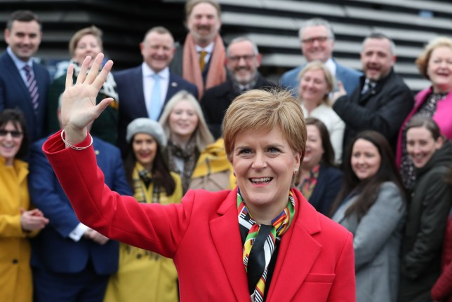 First Minister Nicola Sturgeon joins SNP's newly elected MPs for a group photo call outside the V&A Museum in Dundee. PA Photo. Picture date: Saturday December 14, 2019. See PA story POLITICS Election Scotland. Photo credit should read: Andrew Milligan/PA Wire