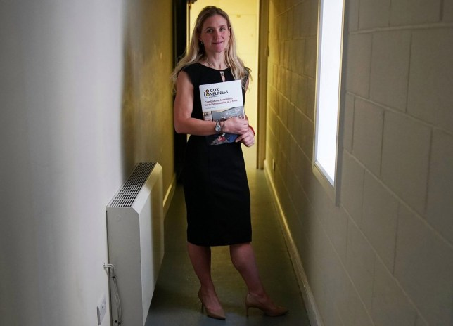 "BATLEY, ENGLAND - DECEMBER 15: Kim Leadbeater, the sister of the late Jo Cox MP, poses with the report of the Jo Cox Commission on December 15, 2017 in Batley, England. The commission was set up by Jo Cox MP before her murder last year. The report has highlighted that the UK should appoint a ""minister for loneliness."" It also stated that loneliness affects nine million people in the UK and is as harmful to health as smoking 15 cigarettes a day. (Photo by Christopher Furlong/Getty Images)"