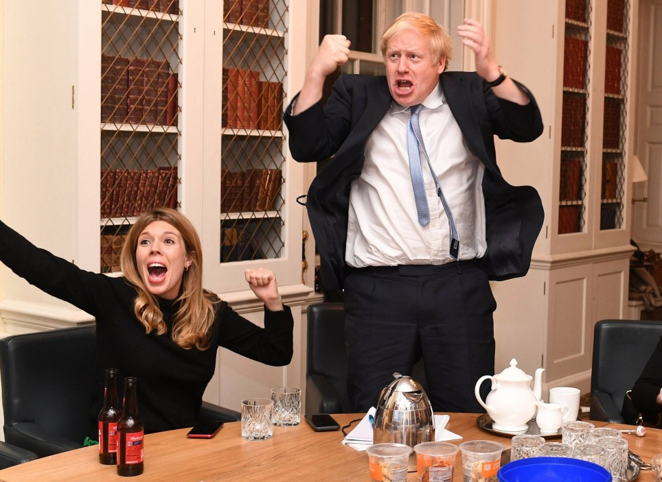 Image ?Licensed to i-Images Picture Agency. 13/12/2019. London, United Kingdom. Boris Johnson Election Night. Britain's Prime Minister Boris Johnson and his partner Carrie Symonds watch the 2019 Election results on the TV in his study in No10 Downing Street. Picture by Andrew Parsons / i-Images