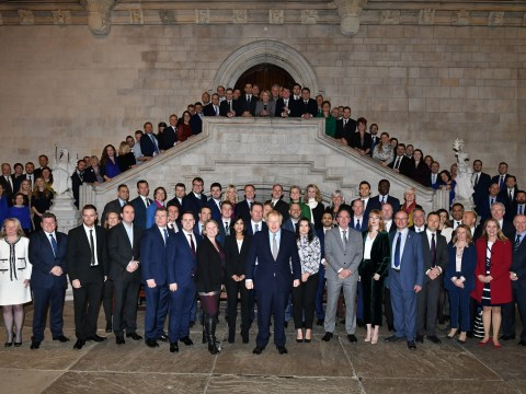 Boris Johnson poses with over 100 newly elected Tory MPs
