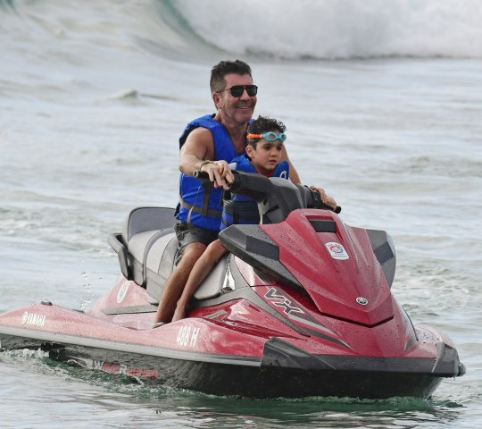 Simon Cowell and son Eric pictured on the beach in Barbados. 18 Dec 2019 Pictured: simon Cowell. Photo credit: SNK/246paps / MEGA TheMegaAgency.com +1 888 505 6342