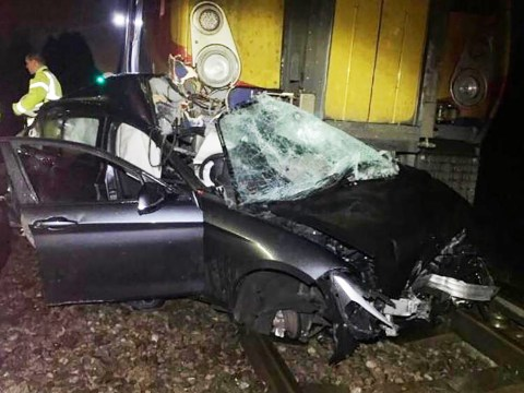 Driver survives car being crushed by train as he leaps out with seconds to spare
