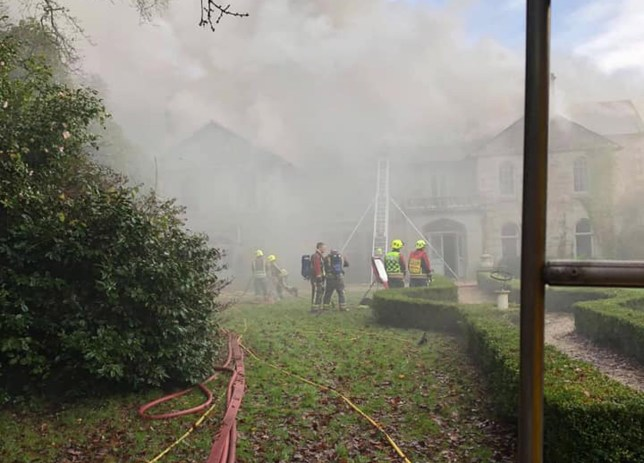 Handout photo issued by Lostwithiel Community Fire Station of firefighters at an 18th century Cornish manor house in Milltown after a fire. PA Photo. Issue date: Saturday December 21, 2019. Three crews from Lostwithiel, Bodmin and Fowey were called to the detached property in Milltown at 8.53am on Saturday after reports of smoke. See PA story FIRE Cornwall. Photo credit should read: Lostwithiel Community Fire Station/PA Wire NOTE TO EDITORS: This handout photo may only be used in for editorial reporting purposes for the contemporaneous illustration of events, things or the people in the image or facts mentioned in the caption. Reuse of the picture may require further permission from the copyright holder.