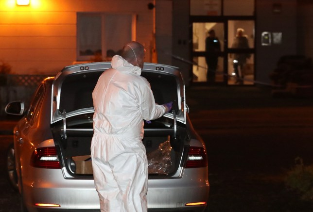 RETRANSMITTED CORRECTING BYLINE TO LIAM MCBURNEY A PSNI forensic officer at the scene on Kinnaird Close in Belfast, after the bodies of a man and a woman were found in an apartment this afternoon. PA Photo. Picture date: Monday December 23, 2019. See PA story ULSTER Police. Photo credit should read: Liam McBurney/PA Wire