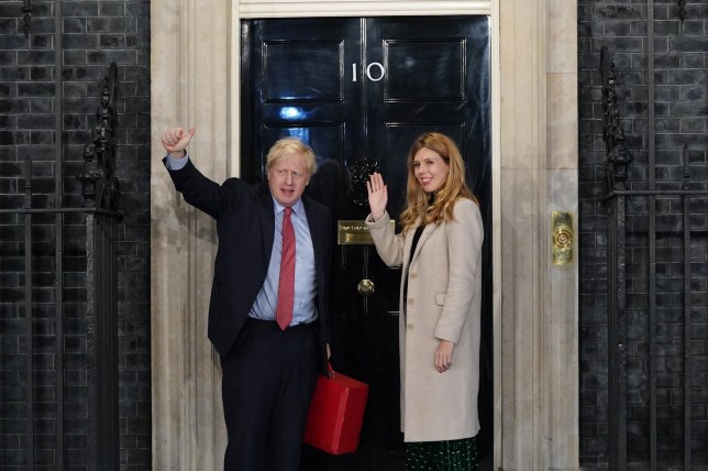 LONDON, ENGLAND - DECEMBER 13: Prime Minister Boris Johnson and his partner Carrie Symonds enter Downing Street as the Conservatives celebrate a sweeping election victory on December 13, 2019 in London, England. Prime Minister Boris Johnson called the first UK winter election for nearly a century in an attempt to gain a working majority to break the parliamentary deadlock over Brexit. As the results roll in the Conservative Party has gained the number of seats needed to win a clear majority at the expense of the Labour Party. Votes are still being counted and an overall result is expected later today. (Photo by Peter Summers/Getty Images)
