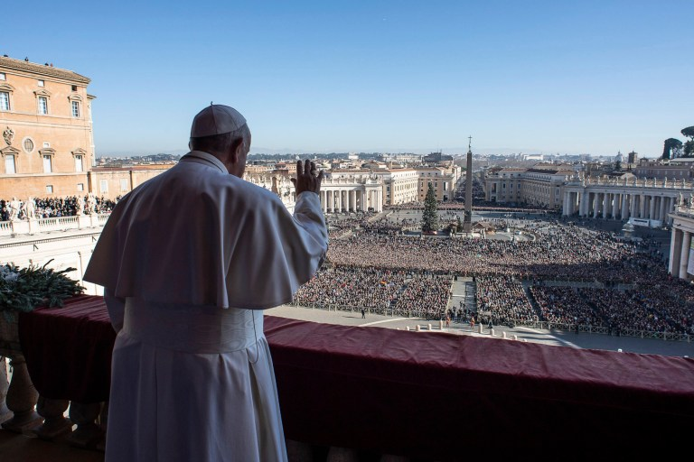 Pope Francis delivers the traditional Urbi et Orbi Christmas Day blessing from the central balcony of St. Peter's Basilica at the Vatican, 25 December 2019.