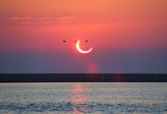 MANAMA, BAHRAIN - DECEMBER 26: Last solar eclipse of the year is seen in Manama, Bahrain on December 26, 2019. (Photo by Ayman Yaqoob/Anadolu Agency via Getty Images)