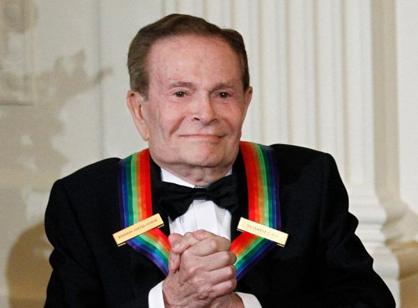 """FILE - In this Dec. 5, 2010, file photo, composer Jerry Herman, one of the recipients of the 2010 Kennedy Center Honors is introduced during a reception in the East Room of the White House in Washington. Herman, the Tony Award-winning composer behind """"Hello, Dolly!"""" and """"La Cage aux Folles,"""" has died at age 88. (AP Photo/Manuel Balce Ceneta, File)"""