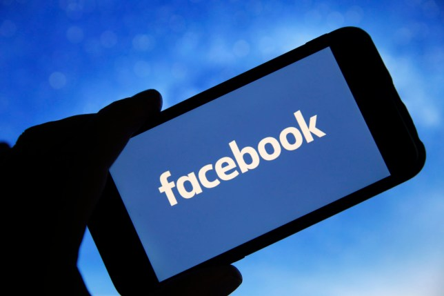 """PARIS, FRANCE - JANUARY 31: In this photo illustration the Facebook logo is seen on the screen of an iPhone on January 31, 2019 in Paris, France. The social media Facebook revealed to have paid teenagers to watch their activities on their phone. The company has offered Internet users to download the application """"Facebook Research"""" to observe all their deeds and actions, against payment. Despite this, Facebook shares soar by 11% in the wake of the announcement of a net profit up 61% to $ 6.9 billion for the last quarter of 2018.(Photo by Chesnot/Getty Images)"""