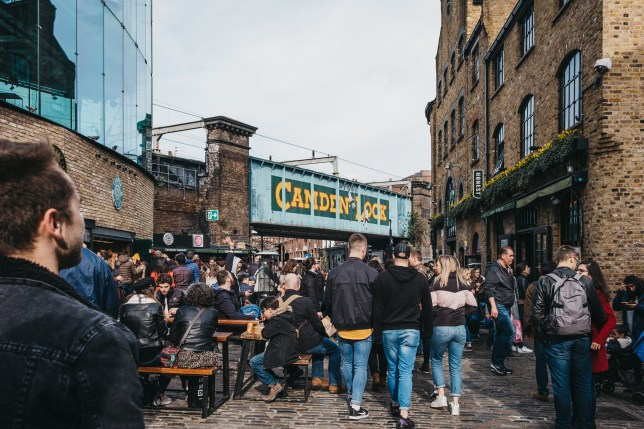 London, UK - March 23,2019: People walking inside Camden Market, London. Started with 16 stalls in March 1974, Camden Market is one of the busiest retail destinations in London.