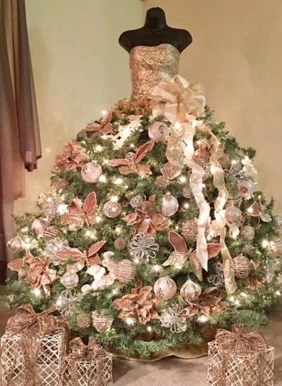 One of the Christmas mannequin trees