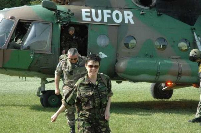Mandy McBain OBE in uniform, getting out of a helicopter