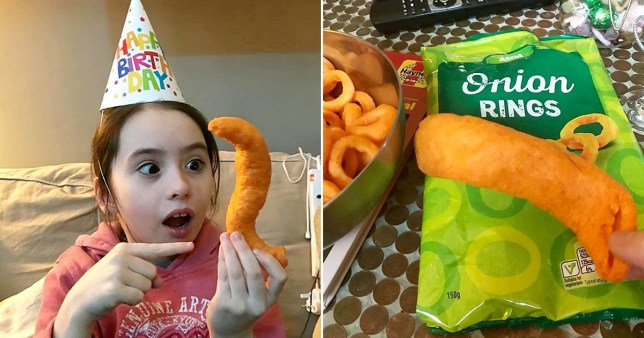 Little girl holding massive crisp
