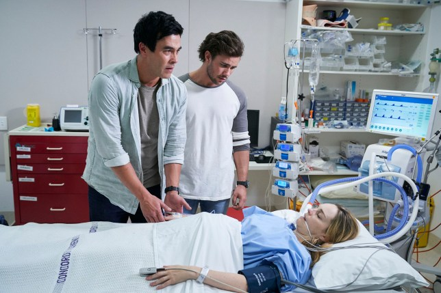 Mason and Justin with Tori in hospital