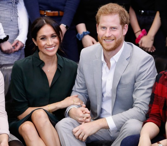 PEACEHAVEN, UNITED KINGDOM - OCTOBER 03: (EDITORS NOTE: Retransmission with alternate crop.) Meghan, Duchess of Sussex and Prince Harry, Duke of Sussex make an official visit to the Joff Youth Centre in Peacehaven, Sussex on October 3, 2018 in Peacehaven, United Kingdom. The Duke and Duchess married on May 19th 2018 in Windsor and were conferred The Duke & Duchess of Sussex by The Queen. (Photo by Chris Jackson/Getty Images)