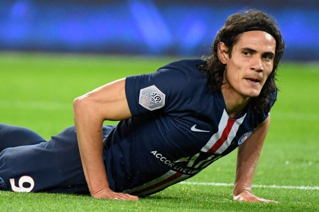 Manchester United and Chelsea transfer target Edinson Cavani picks himself up off the turf while playing for PSG
