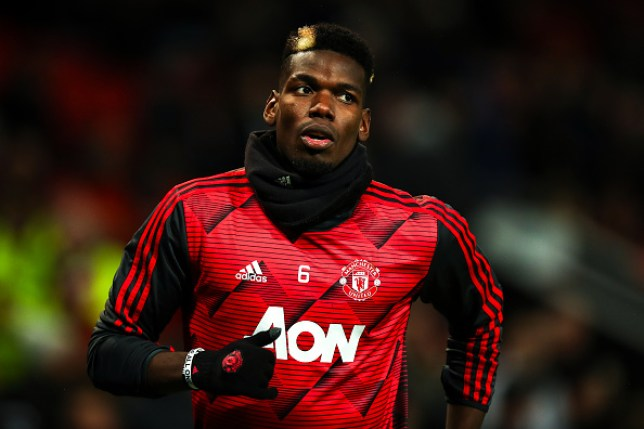 Paul Pogba warms up for Manchester United