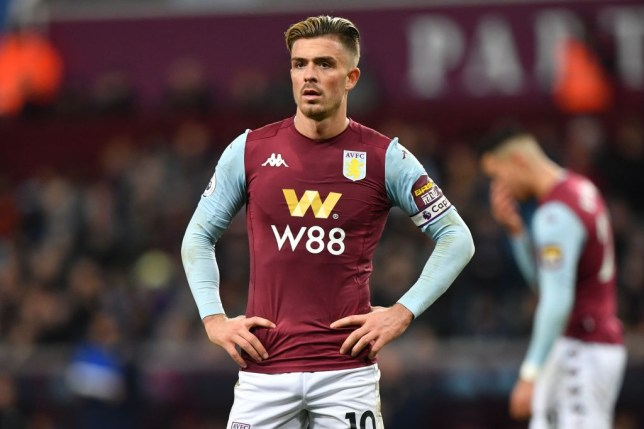 Manchester United and Liverpool transfer target Jack Grealish stands hands on hips while playing for Aston Villa