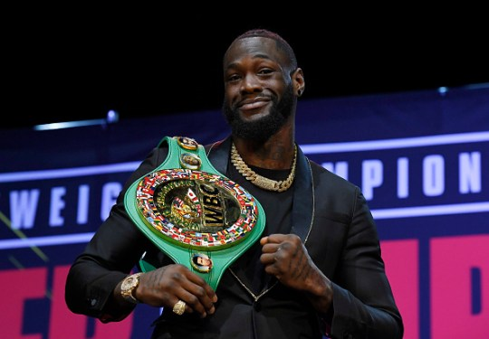 Deontay Wilder poses with the WBC belt