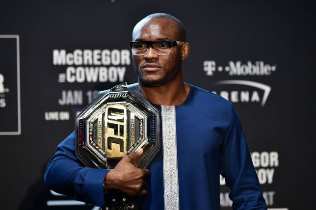 Kamaru Usman poses for pictures with his UFC title