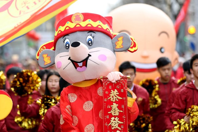 Revelers perform during celebrations for the Chinese New Year parade