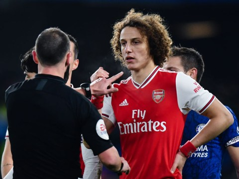 Shkodran Mustafi apologises to Arsenal teammate David Luiz after his error against Chelsea