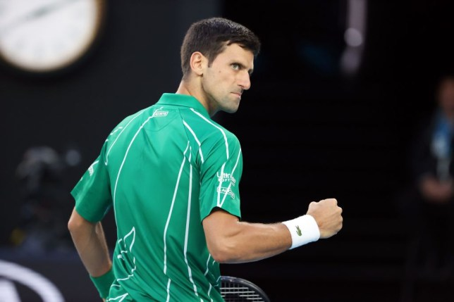 Serbia's Novak Djokovic reacts after a point against Canada's Milos Raonic during their men's singles quarter-final match on day nine of the Australian Open tennis tournament in Melbourne on January 28, 2020.