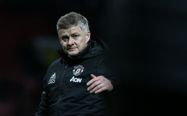 Ole Gunnar Solskjaer gestures to someone during a Manchester United game