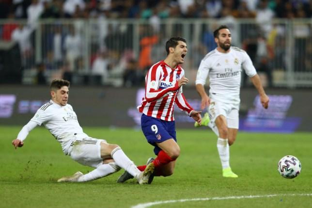 Federico Valverde fouls Alvaro Morata