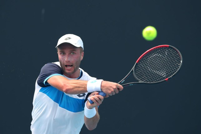 Liam Broady of Great Britain plays a backhand in his match against Ilya Ivashka of Belarus during 2020 Australian Open Qualifying at Melbourne Park on January 14, 2020 in Melbourne, Australia.
