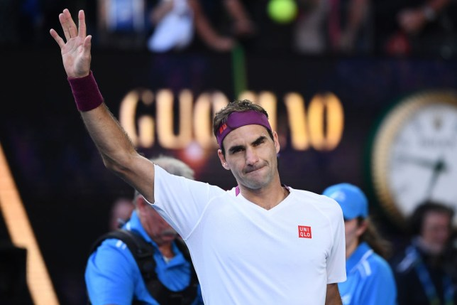Roger Federer of Switzerland celebrates after winning match point during his Men's Singles Quarterfinal match against Tennys Sandgren of the United States on day nine of the 2020 Australian Open at Melbourne Park on January 28, 2020 in Melbourne, Australia.