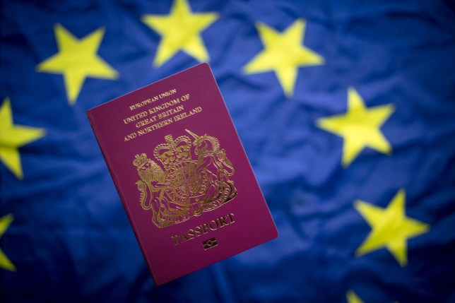 A UK passport against the backdrop of an EU flag