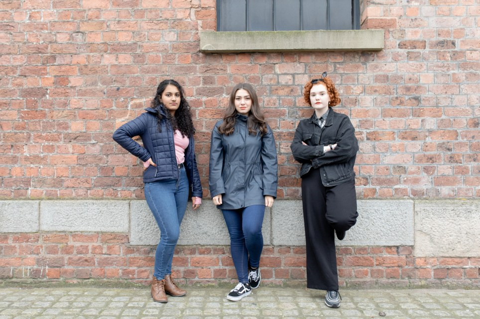 Young girls from Liverpool posing outside
