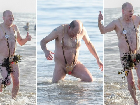 Brave man takes Rudolph for a New Year dip in the icy waters of the North Sea