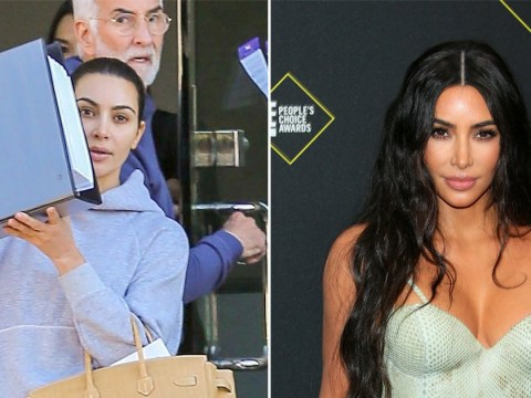 Kim Kardashian hides her face with a giant binder of secrets as she leaves husband Kanye West's office