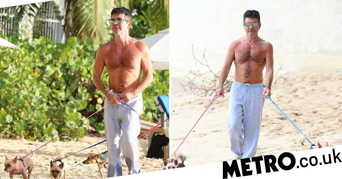 Simon Cowell keeps up his exercise with topless beach stroll