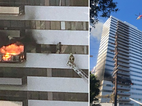 Man scales building as 'suspicious' fire rips through block of flats