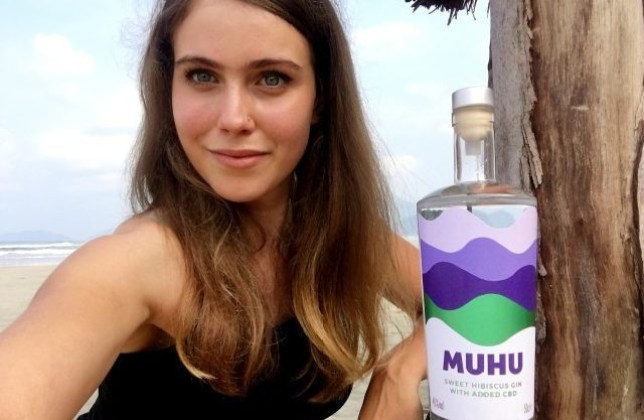 Sally Wynter on the beach with her gin Muhu on the side