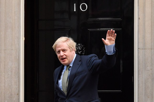"""TOPSHOT - Britain's Prime Minister and Conservative Party leader Boris Johnson arrives at 10 Downing Street in central London on December 13, 2019, following an audience with Britain's Queen Elizabeth II at Buckingham Palace, where she invited him to become Prime Minister and form a new government. - Conservative Prime Minister Boris Johnson on Friday hailed a political """"earthquake"""" in Britain after a thumping election victory which clears the way for the country to finally leave the EU next month after years of paralysing deadlock. (Photo by Ben STANSALL / AFP) (Photo by BEN STANSALL/AFP via Getty Images)"""