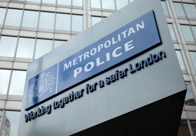 London, England - May 8, 2011: The famous New Scotland Yard sign, outside the Metropolitan police headquarters in London.