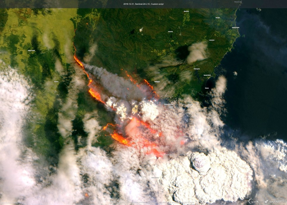 A satellite image of the Batemans Bay shows smoke and fire from wild bushfires in Australia, December 31, 2019. Picture taken December 31, 2019. EUROPEAN UNION, COPERNICUS SENTINEL DATA/Handout via REUTERS THIS IMAGE HAS BEEN SUPPLIED BY A THIRD PARTY. MANDATORY CREDIT. NO RESALES. NO ARCHIVES