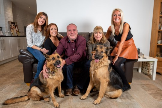 (L-R) Kealy Gulrajami 33, Gemma Viner 31, Paul Viner 55, Toni Viner 55, and Leah Bolt, 28 with German Shepard???s Shebia age 7 and Sky age 2. See SWNS copy SWCAnest: A dad-of-three was left with empty nest syndrome after his adult daughters all left home- and dealt with it by rescuing neglected dogs from killing stations abroad. Paul Viner, 55, fell into a deep depression and struggled with his identity- until he turned his efforts into saving dogs from certain death. After aching to feel needed again, Paul in time rescued three dogs; Shane, Sheba and Sky who had all suffered brutal cruelty at the hands of humans.